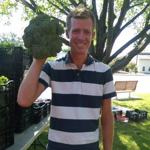 Fred holds up his 3lb broccoli, grown using DAIRY DOO products