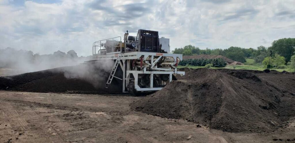 compost, used to improve soil health, is run through the turner